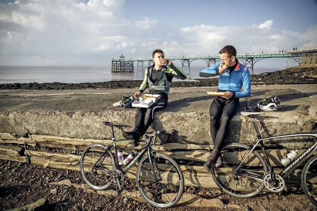 Two cyclist's have lunch on the seafront at Clevedon in Somerset