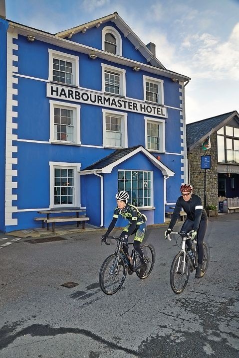 Cyclists outside the Harbourmaster Hotel in Aberaeron