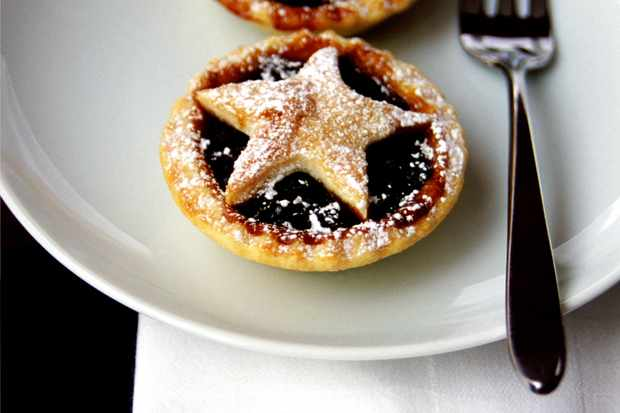 A couple of homemade mince pies on a plate