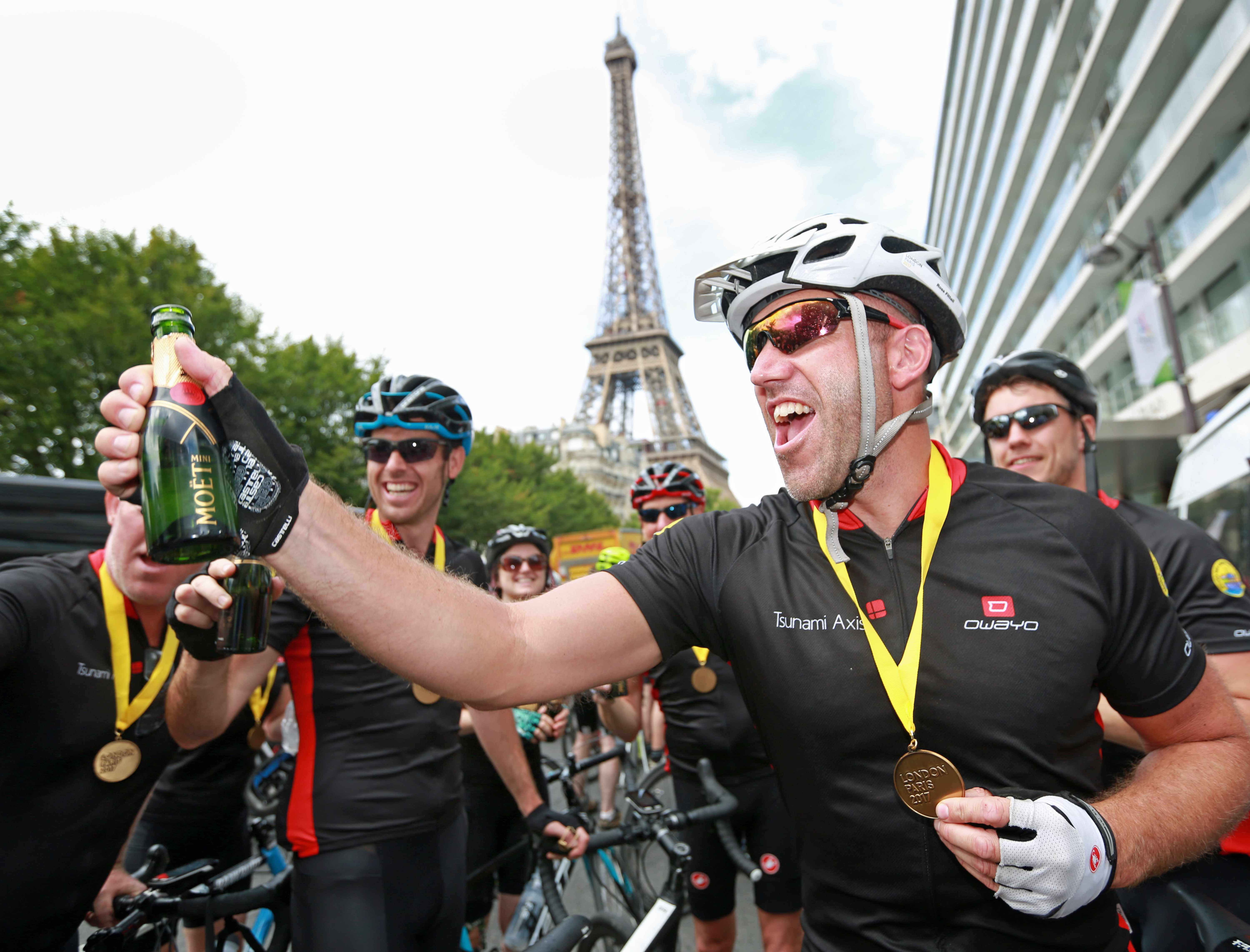 Riders celebrate completing Hot Chilee's London-Paris ride in 2017
