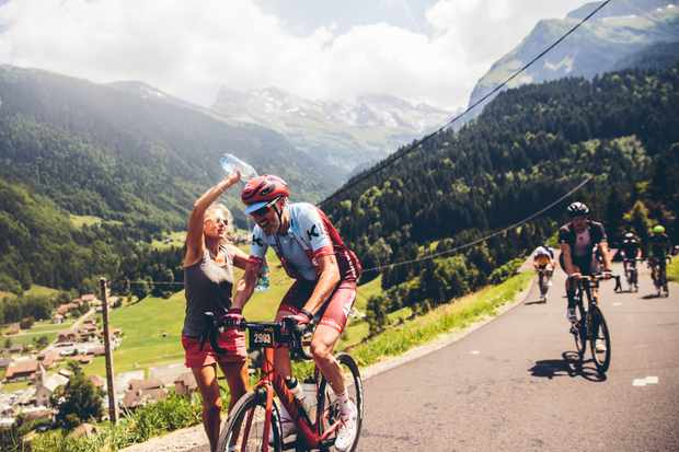 Cycling Plus Editor Rob Spedding is doused with water on the Col de La Colombiere during the 2018 Etape du Tour Sportive