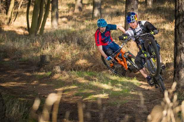 Danny MacAskill riding doing a wheelie