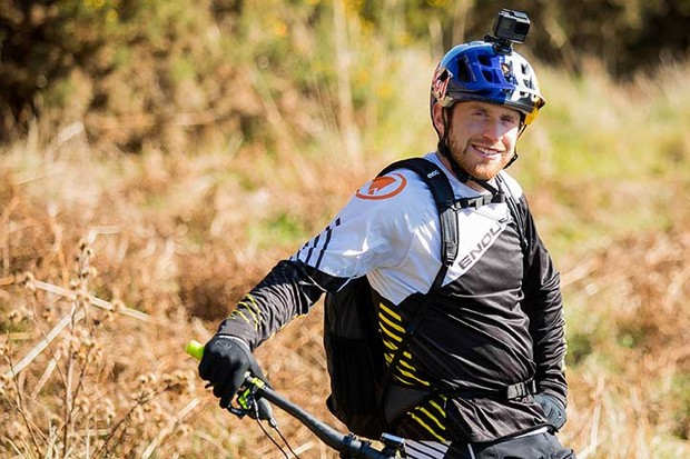 Danny Macaskiil casual posed on bike
