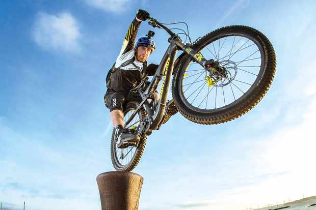 Danny Macaskill hopping on a bollard near water