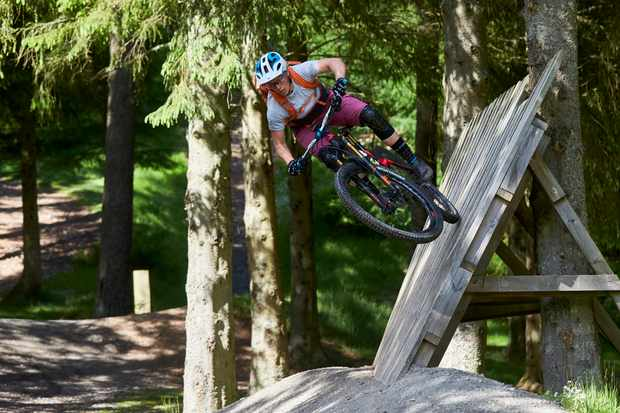 Tracy Moseley schooled MBUK at the Glentress freeride park, hitting the wallride with ease! Credit: Steve Behr