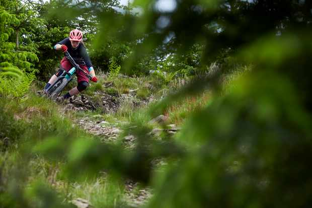 Martha Gill has style for miles as she hits one of the enduro trails. Credit: Steve Behr