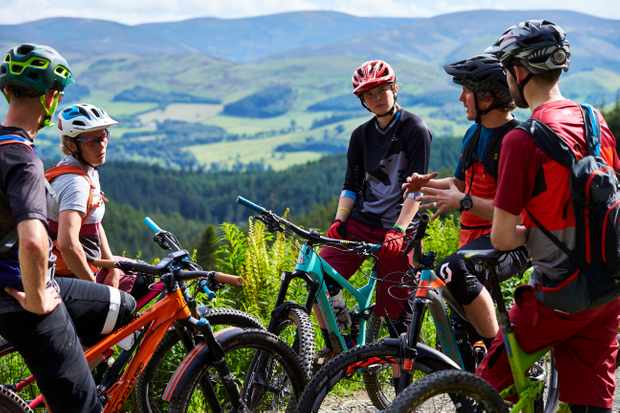 The MBUK Wrecking Crew checks out the gorgeous scenery and riding at Glentress in Scotland. Credit: Steve Behr