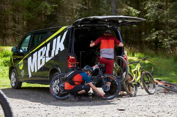 Jimmer and JCW unload the MBUK van at Glentress. Credit: Steve Behr
