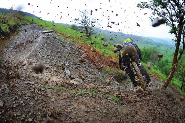 This is why we love Sam Hill, ripping and roosting turns, no matter what the weather is doing. Photo: Andy Lloyd