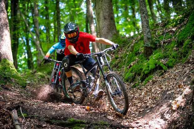Vincent Tupin riding a Scott Gambler leads MBUK Features Editor Alex Evans on a downhill trail outside Evian in France