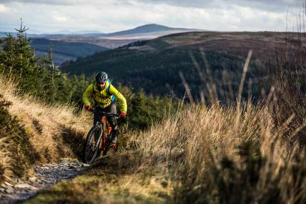 Alex Evans rides the climb on the Dolen Machno trail at Penmachno for a MBUK Wrecking Crew feature