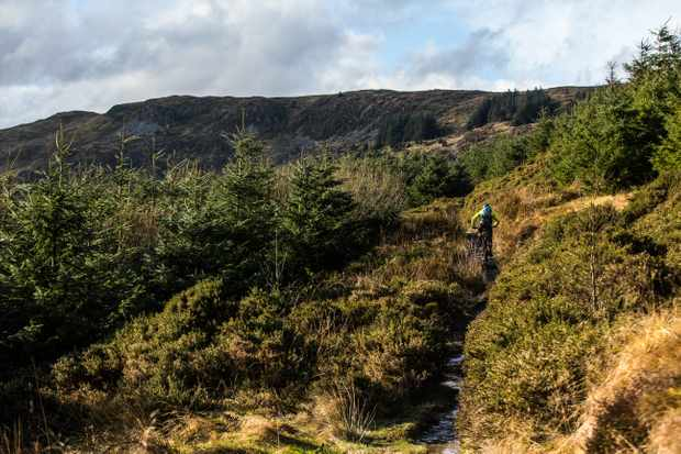 Alex Evans rides the Dolen Machno trail at Penmachno across the moor on a Wrecking Crew feature