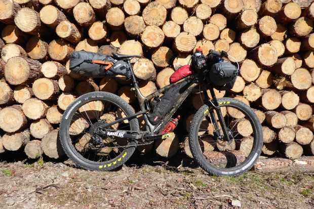 Loads fo travel kit strapped to bike packers bike