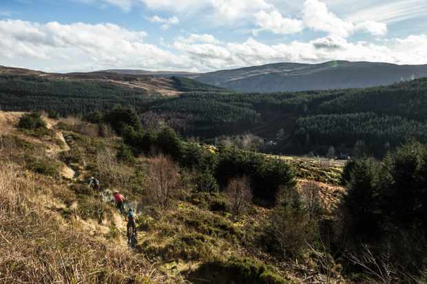 Leo Houseman, Ed Thomsett and Alex Evans ride the Dolen Machno trail at Penmachno in early spring on an MBUK Wrecking Crew
