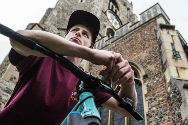 Tom Cardy poses for the camera on a MBUK photoshoot in front of a church in Chelmsford, Essex