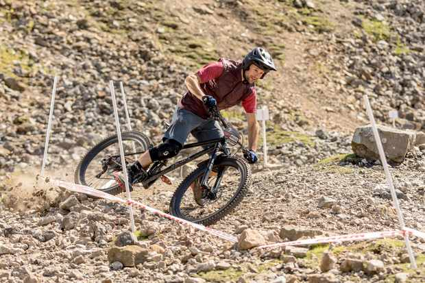 Alex Evans rides a Swarf Cycles Contour mountain bike at the Ard Rock Enduro