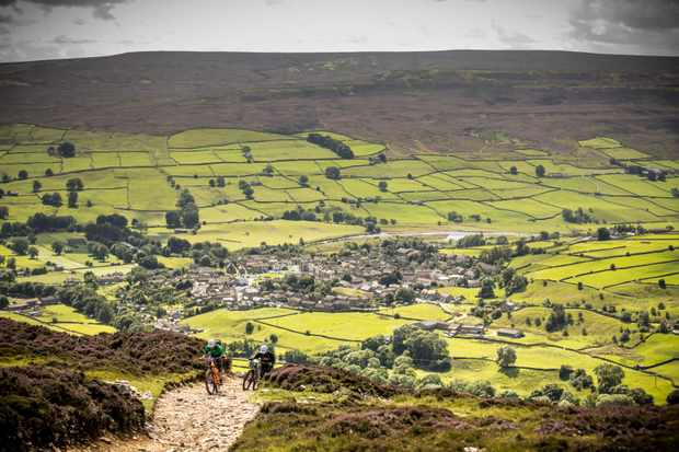 mountain bikers try to conquer one of the climbs at the Ard Rock enduro