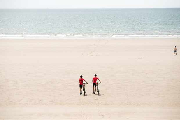 MBUK's welsh coast to coast challenge for cannondale finishes on a beach near port talbot in South Wales
