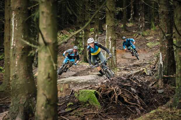 three riders on the trails at BikePark Wales
