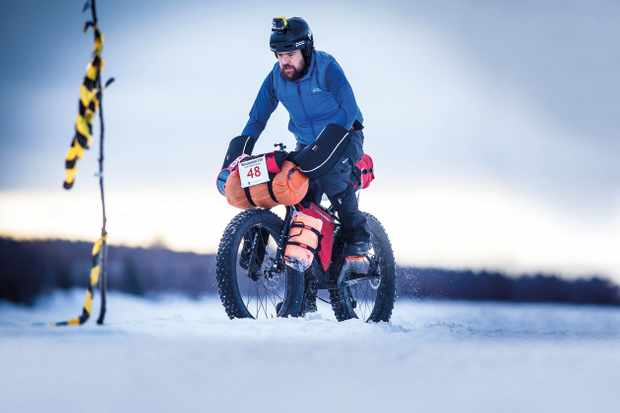 Matt Orton riding a fatbike across snow in the Rovaniemi 150, February 2016