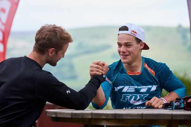 Enduro racer Richie Rude arm wrestles at BikePark Wales