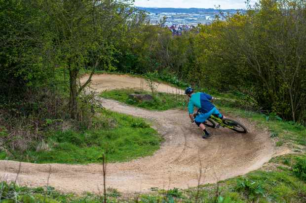 Alex Evans drifts a berm at Sheffield's parkwood Springs trail centre