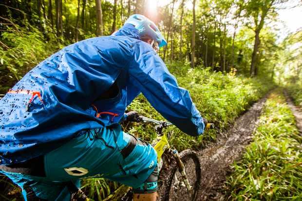 Rider heading down a sloppy, muddy trail