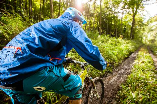 Rider heading down a sloppy, muddy trail