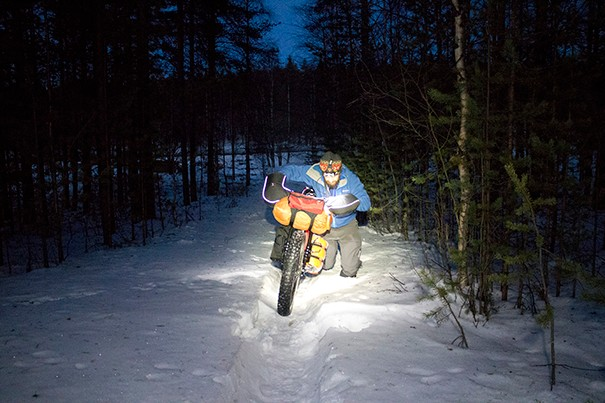 Pushing a bike through deep snow