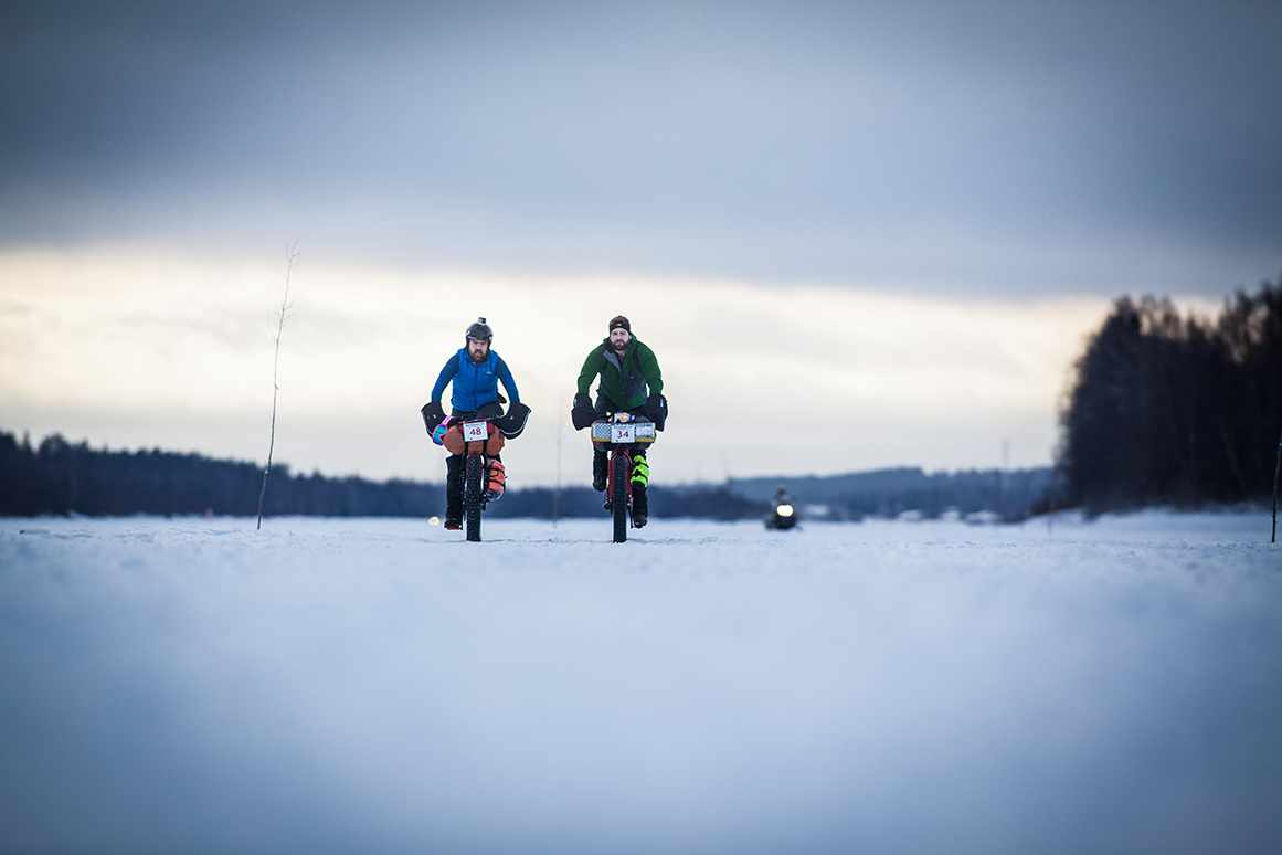 Matt and Tom Riding acros snow expanse in the Rovaniemi 150