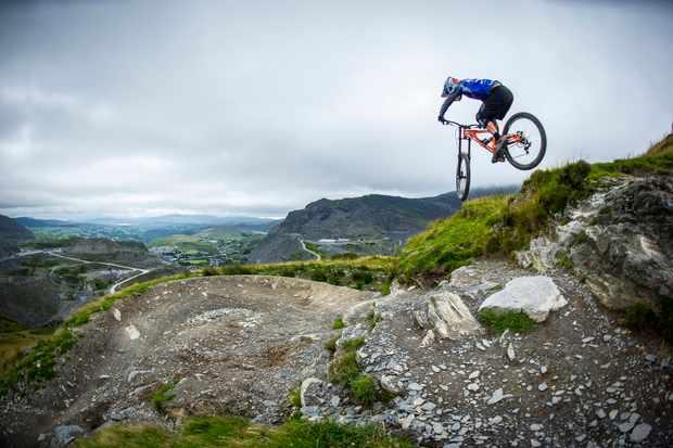 Antur Stiniog downhill tracks ridden by a team ride.io rider on an MBUK photoshoot
