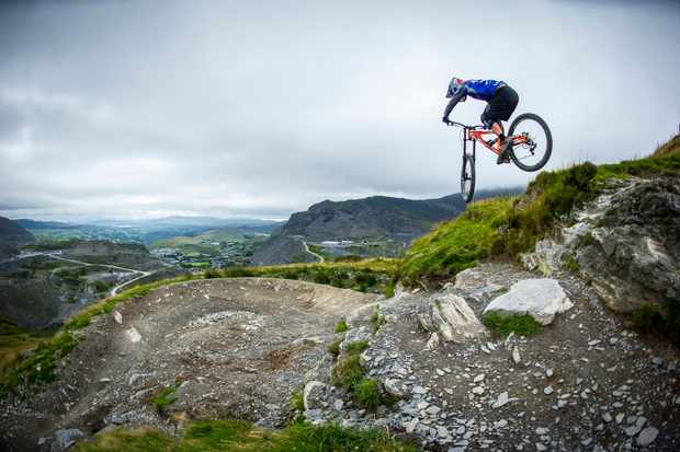 Antur Stiniog downhill tracks ridden by a team ride.io rider on an MBUK photoshoot