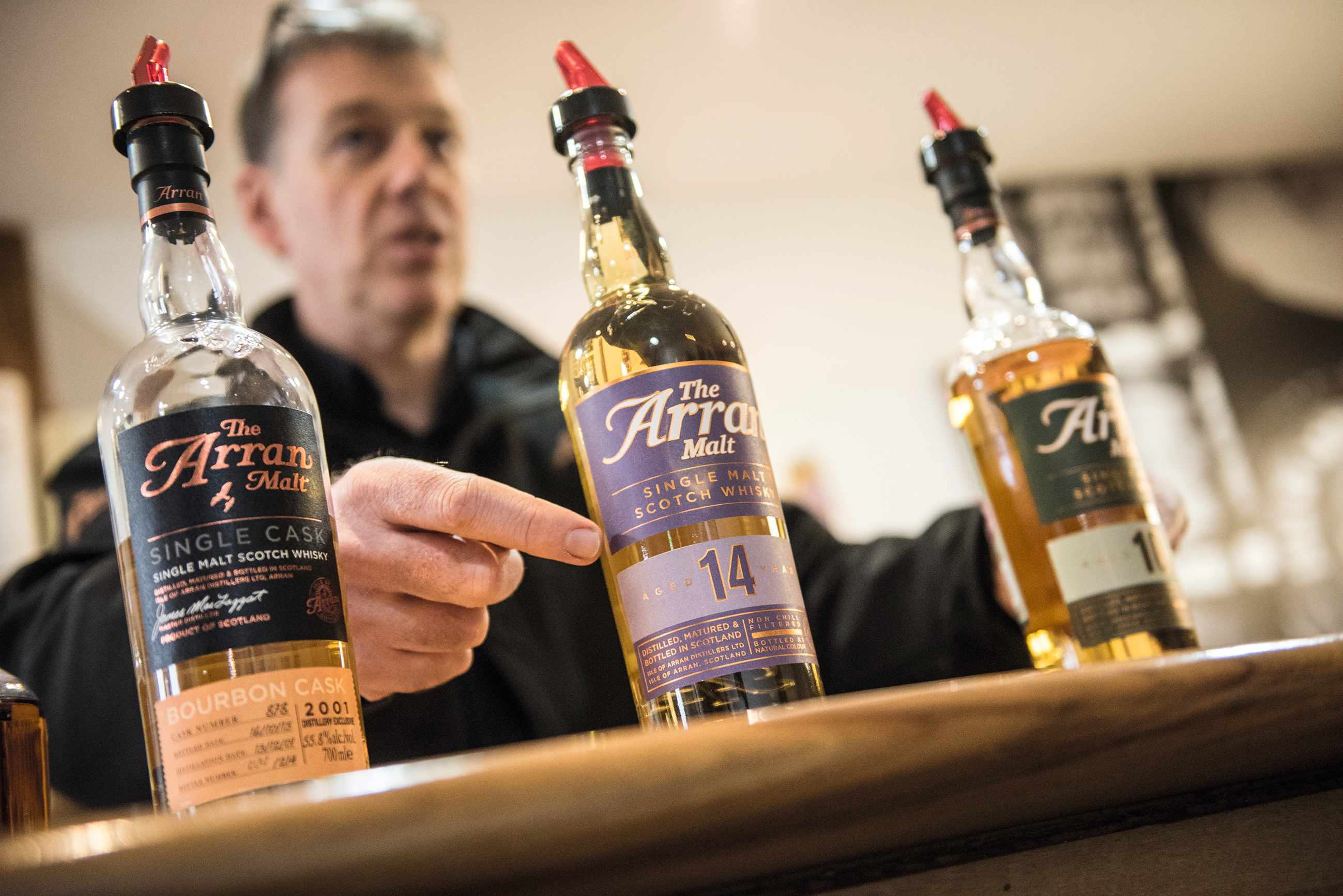 A line up of single malt whiskies from the Isle of Arran