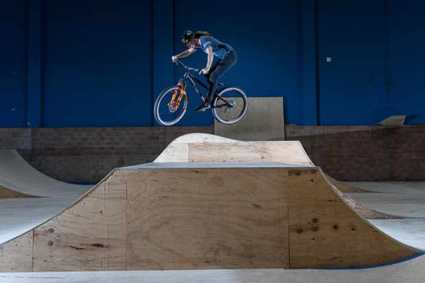 Manon Carpenter jumps a ramp in Rampworld skatepark in Cardiff