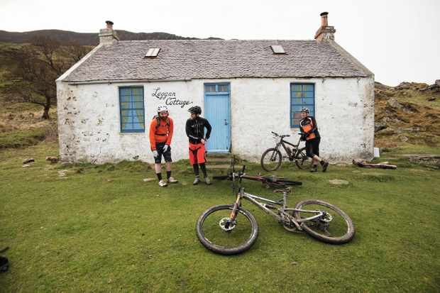 Riders chill out by and abandoned cottage on the Isle of Arran