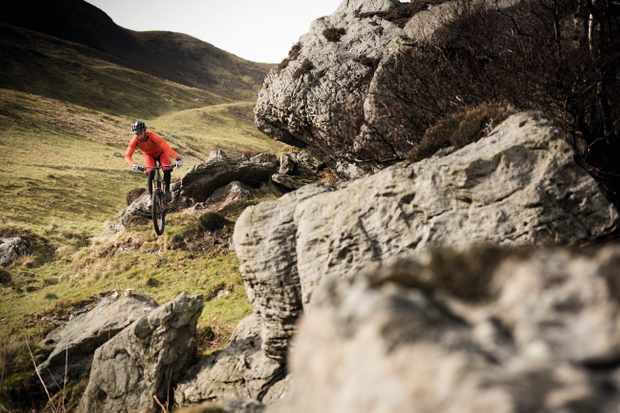 Marc Beaumont popping over rocks on the Isle of Arran