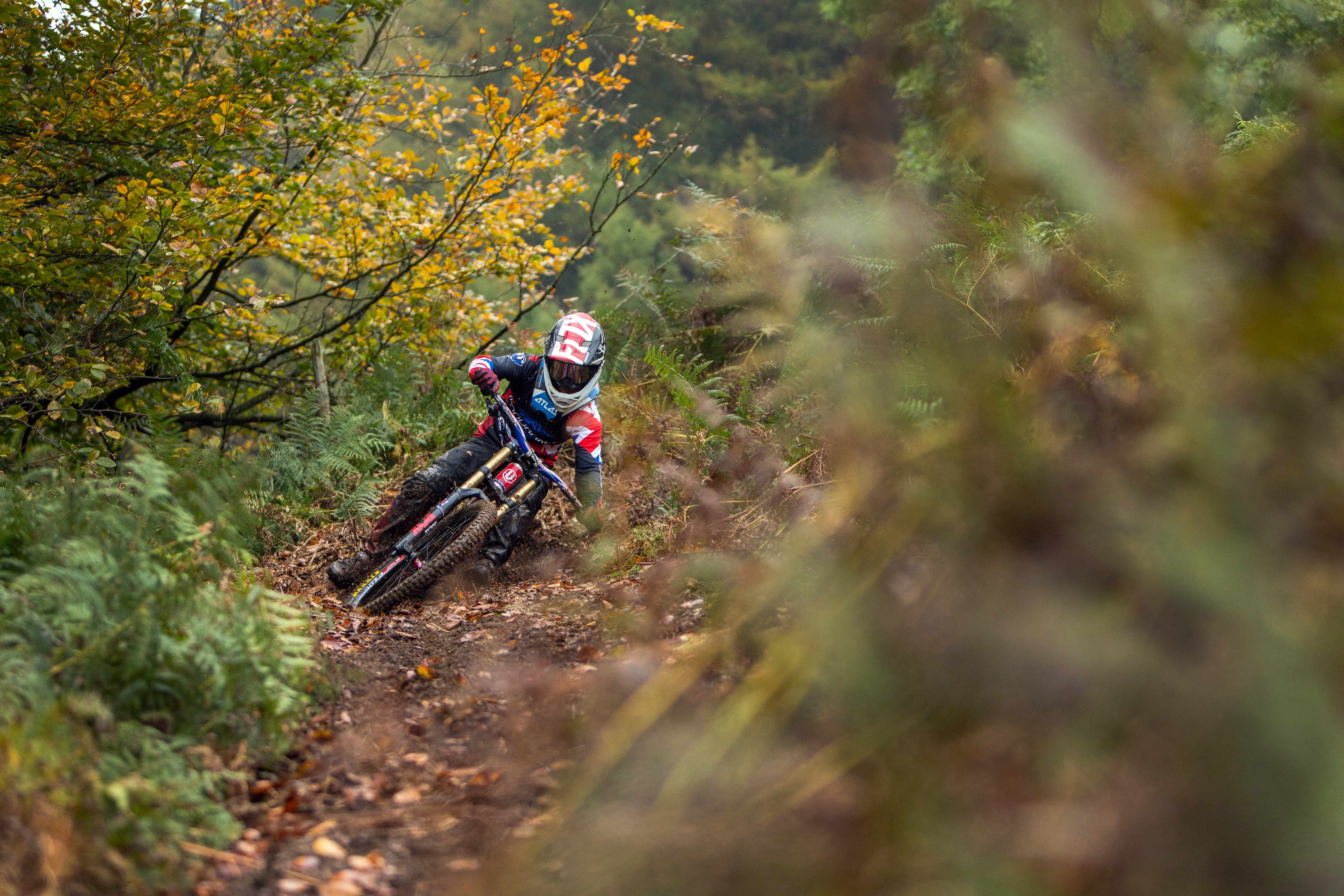 Laurie Greenland riding a corner on his mountain bike in South Wales