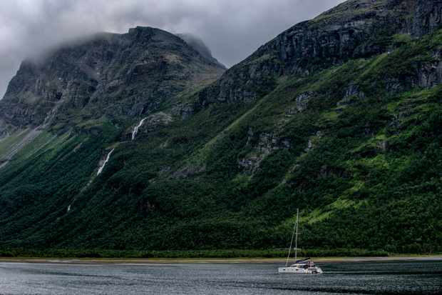 Yacht sailing through the Norwegian fjords