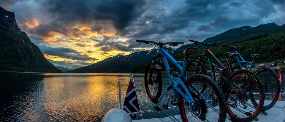 Mountain bikes on the back of a yacht during a sailing and biking trip in the Arctic Circle