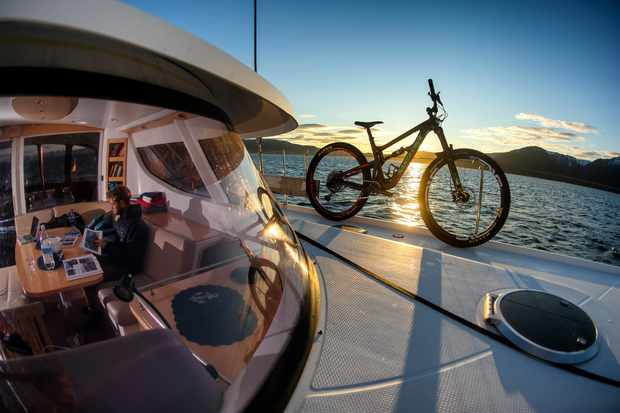 Bike on a yacht and a view inside the cabin