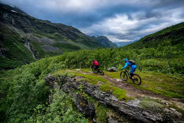 Thomas Klingenberg and Ed Thomsett ride along a cliff top in Norway