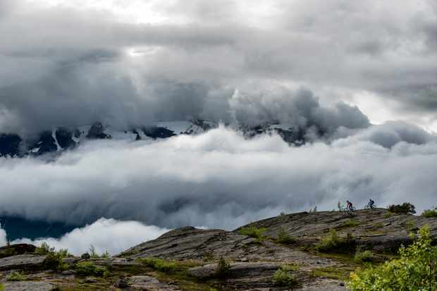 Ed Thomsett and Thomas Klingenberg ride through the clouds in Skibotn, Norway