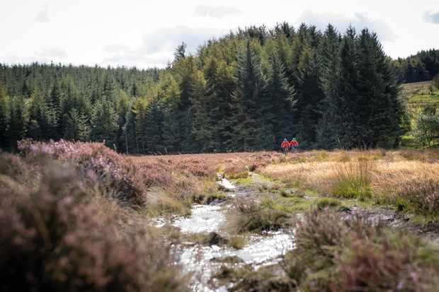 Mountain bikers water splash on North York Moors