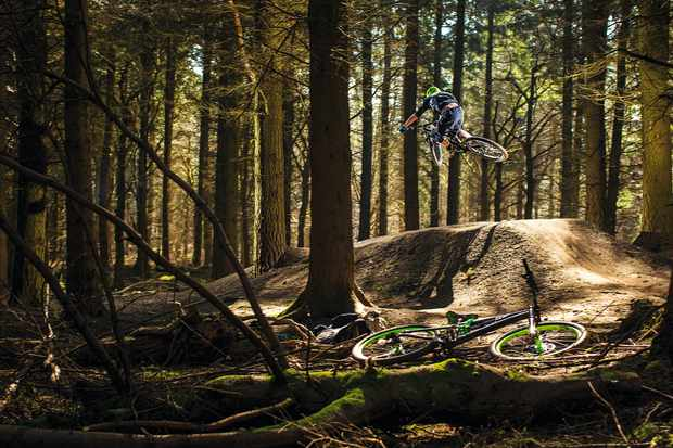 A rider hits a table top jump at Forest of dean