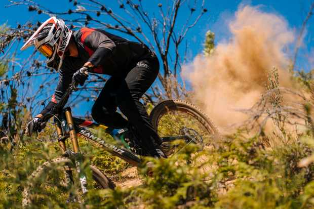 Greg Minnaar rides a dusty corner on his Santa Cruz V10 in Stellenbosch, South Africa