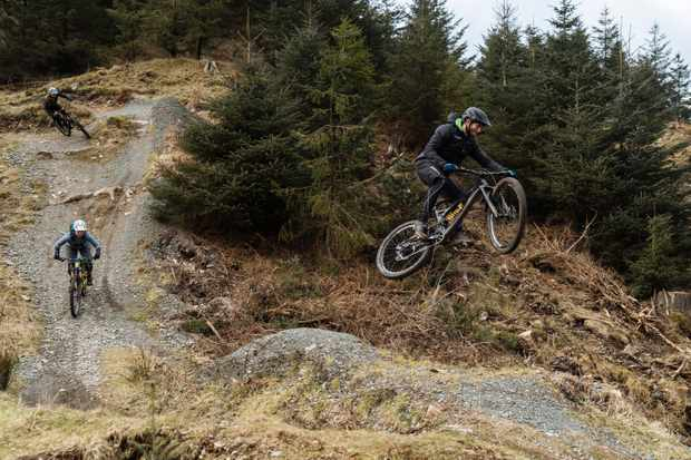 Adam Brayton does a jump at Grizedale trail centre