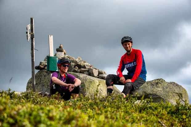 Sverre and our Ed take a quick break from the lung-busting climbs and bone rattling descents. Credit: Andy Lloyd