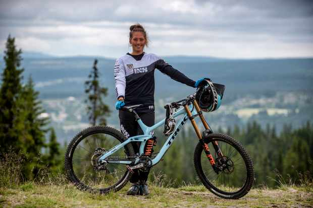 Mille Johnset poses with her Trek Session 9.9 in Hafjell Bike Park