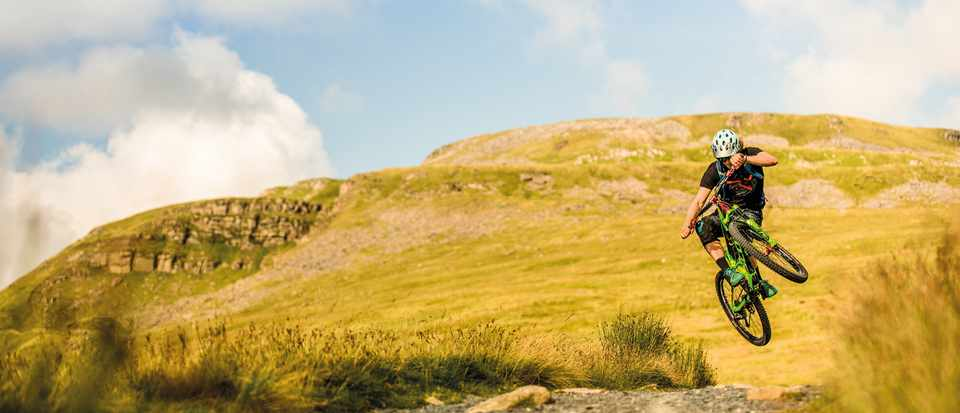 Sam Flanagan jumps on his mountain bike coming down Ingleborough in the Yorkshire Dales