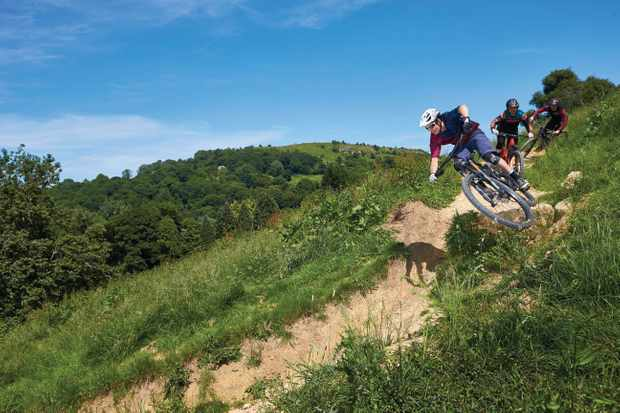 Jonny Ashelford riding a Specialized Stumpjumper , James Van Gawler riding a Giant Reign and Luke Marshall riding a Yeti mtb. 417 Bike Park. Witcombe, Gloucestershire. June 2018.